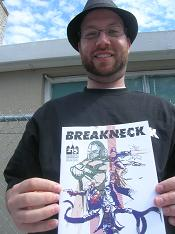 Mark Bertolini  writer  holding a copy of Breakneck 1 Free Comic Book Day 2012 MED at Image Collections in Streetsville Mississauga Ontario Canada 20